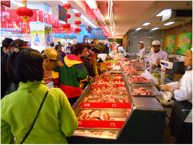 The very busy pork counter at a Shanghai supermarket.