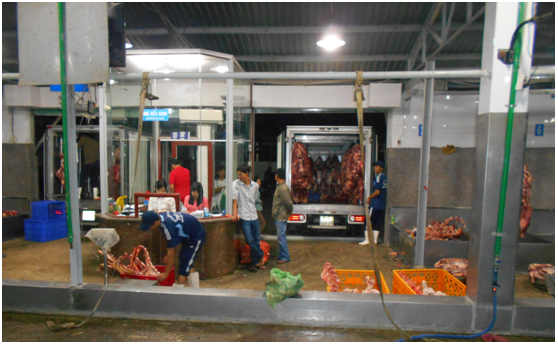 Beef being loaded into small refrigerated trucks for delivery to wet markets.