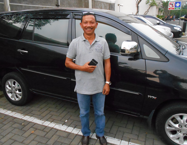 Nyoman with his ever-present grin, the latest model Toyota, smart phone and RM Williams boots.