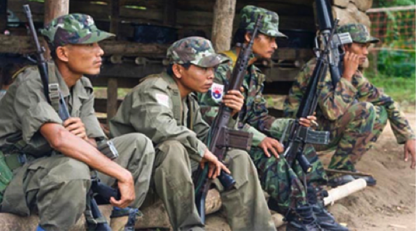 Karen fighters control the Burmese border where cattle and buffalo cross the river into Thailand at Mae Sot.